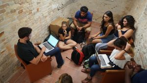 A professor finds a small space to meet with students.